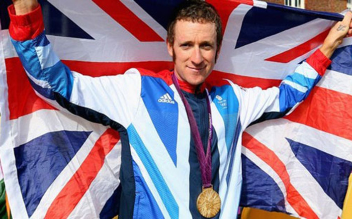 Olympic gold medallist Bradley Wiggins of Great Britain celebrates after the Victory Ceremony following the men's Individual Time Trial. Picture: London2012.com