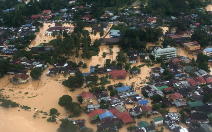 FILE: An aerial view showing houses submerged in floodwaters in Pengkalan Chepa, near Kota Bharu on December 27, 2014. Malaysia has experienced its worst flooding in decades. Picture: AFP.