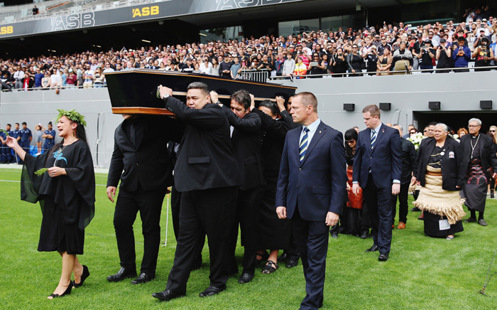 The casket of New Zealand All Blacks rugby legend Jonah Lomu is carried onto New Zealand's home of rugby, Eden Park, for a memorial service in Auckland on 30 November, 2015. Picture: AFP.