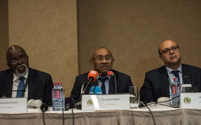 FILE: Vice President of the Confederation of African Football (CAF) Amaju Pinnink, President of CAF Ahmad Ahmad and Acting general secretary of CAF Essadik Alaoui look on during a press conference after an extraordinary meeting with CAF executives at the Kempinski Hotel in Accra on 30 November 2018. Picture: AFP