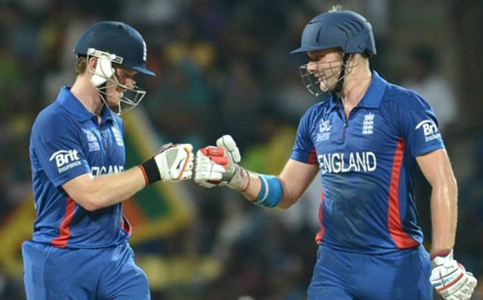 England cricketer Eoin Morgan (L) congratulates Luke Wright after a six during the ICC Twenty20 Cricket World Cup's Super Eight match between England and New Zealand in Pallekele on 29 September, 2012.. Picture: AFP.