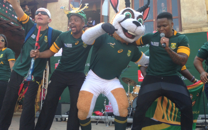 Musician Lloyd Cele performs on stage with fans and the Springboks' mascot. Picture: Vumani Mkhize.