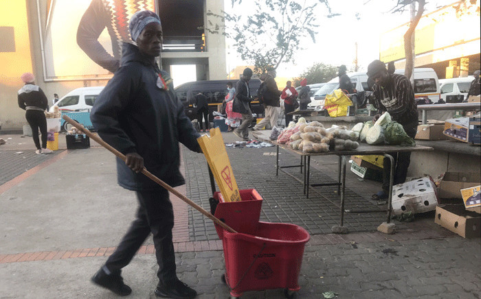 It looks like masks are optional in parts of Soweto; most people are either not wearing them or they have than hanging on their chins. Picture: Kgomotso Modise/EWN.