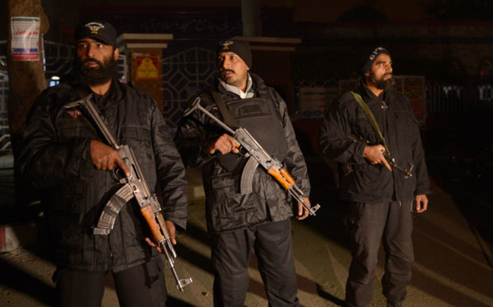 Pakistani police commandos stand guard during a rally in support of the 140 victims of the army run school shooting in Peshawar, in front of radical Red mosque after its hardline cleric refused to condemn the massacre on a television talk-show, in Islamabad on 18 December, 2014. Picture: AFP.