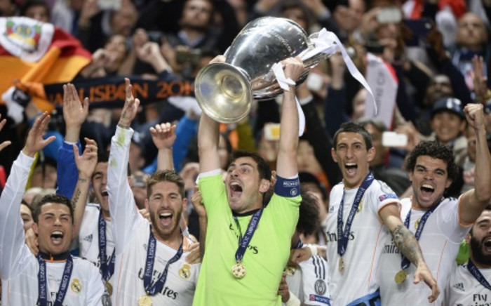 Real Madrid's goalkeeper Iker Casillas and teammates celebrate with the trophy at the end of the UEFA Champions League Final on 24 May 2014. Picture: AFP