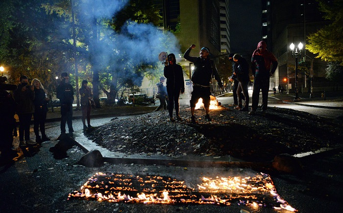 Protesters burn the American flag outside the Mark O. Hatfield United States Courthouse in Portland, Oregon, on 4 November 2020. Picture: AFP