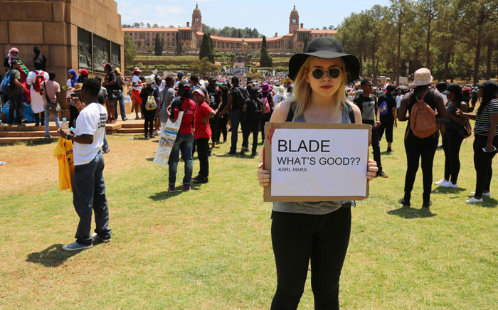 FILE: A student holds a placard during the Fees Must Fall protest at the Union Buildings. Picture: Christa Eybers/EWN.