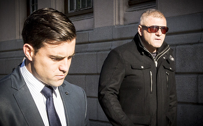 Murder accused David Forbes leaves the Magistrates Court with his lawyer Ross McKernan after the case was postponed for further ballistics and DNA investigation. Picture: Thomas Holder/EWN