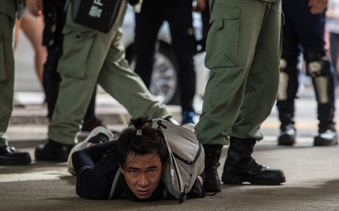 Riot police detain a man as they clear protesters taking part in a rally against a new national security law in Hong Kong on 1 July 2020, on the 23rd anniversary of the city's handover from Britain to China. Picture: AFP
