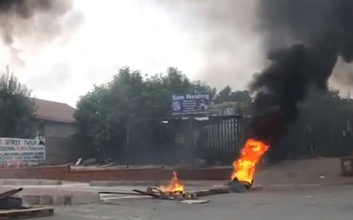 Debris burns in Alexandra during a service delivery protest on 3 April 2019. Picture: EWN