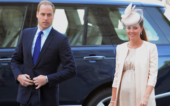 FILE: Britain's Prince William (L) and his wife Catherine, Duchess of Cambridge. Picture: AFP.