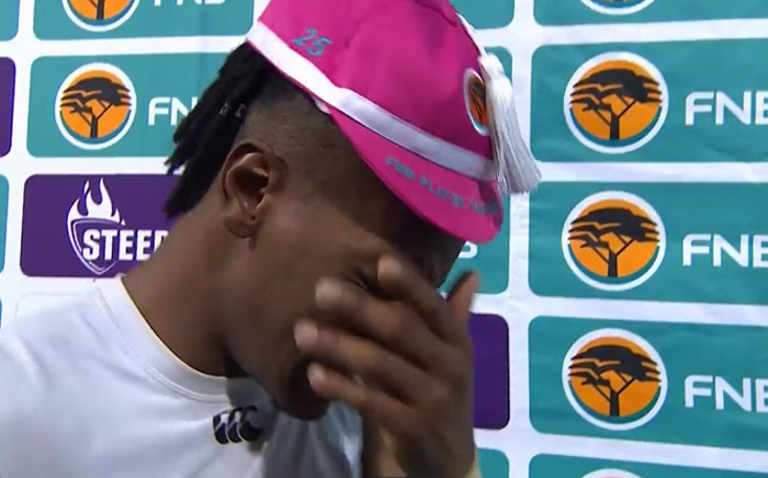A screengrab shows Wits wing Bin Kasende Kapepula who became emotional as he spoke about the death of his girlfriend Christine Osborne.
