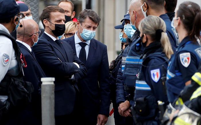 French President Emmanuel Macron (3rd-L) and Nice Mayor Christian Estrosi (4th-L) visit the scene of a knife attack at the Basilica of Notre-Dame de Nice in Nice on 29 October 2020. Picture: AFP