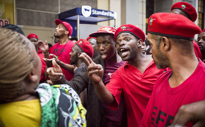 During protests outside of Parliament, there were heated exchanges between ANC and EFF supporters. Picture: Thomas Holder/EWN