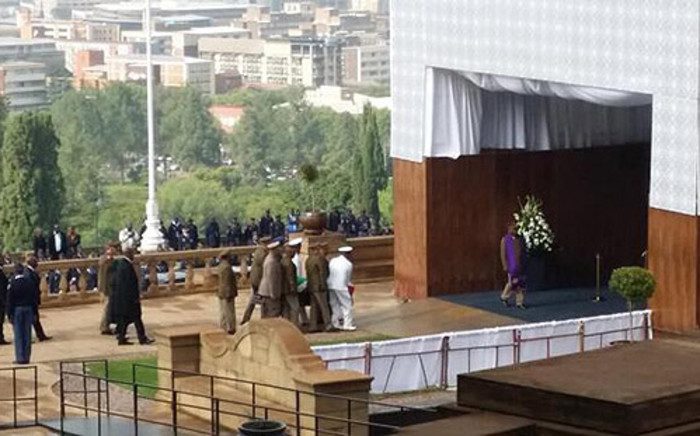 Nelson Mandela's body is carried by into the Nelson Mandela Amphitheatre at the Union Buildings by SANDF soldiers on 11 December 2013. Picture: GCIS.