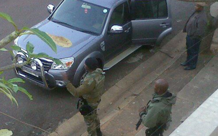 Twenty officers were arrested in a raid by the Hawks on Wednesday.