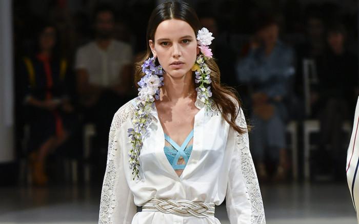 FILE: A model walks down a runway during Paris Fashion Week, France. Picture: fashionweekonline.com.