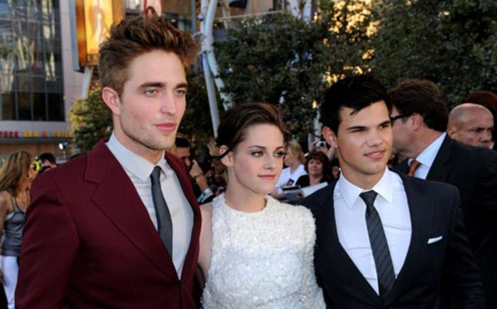 """(L-R) Actors Robert Pattinson, Kristen Stewart and Taylor Lautner at the premiere of Summit Entertainment's """"The Twilight Saga: Eclipse"""" during the 2010 Los Angeles Film on June 24, 2010 in Los Angeles, California.  Picture: AFP."""