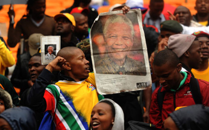 Crowds gather at the FNB Stadium for a memorial service for former South African President Nelson Mandela on 10 December 2013. Picture: Werner Beukes/Sapa/Mandela Pool