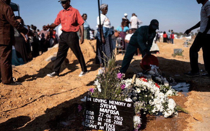 Flowers are laid at the grave of Silvia Maphosa during his funeral in Harare on August 4, 2018, shot four days ago during post-election violence which erupted the day after the nation went to the polls in national elections. Picture: AFP.