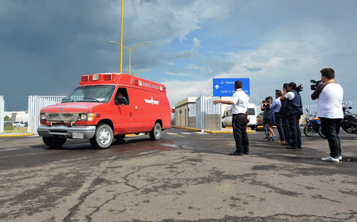 An ambulance is seen at the airport of Durango, in northern Mexico, after a plane carrying 97 passengers and four crew crashed during take-off on 31 July, 2018. Picture: AFP.