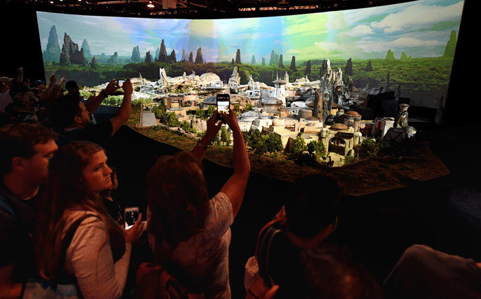 'Star Wars' fans view plans at the California and Florida Disneylands for the new development that will open in 2019 during the D23 expo fan convention at the Convention Center in Anaheim, California, on 16 July 2017. Picture: AFP.