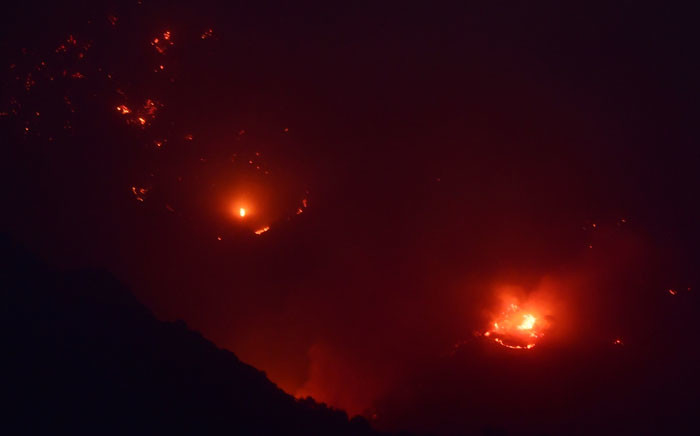 Fire burns on a hillside at the Thomas Fire, 16 December 2017 in Montecito, California. Picture: AFP