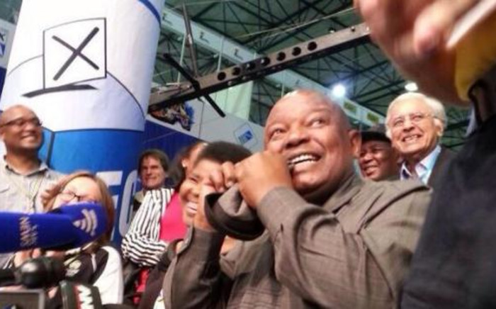 Cope leader Mosiuoa Lekota 'eats his hat as promised after his party scored low numbers on 9 May 2014. Picture: Sebabatso Mosamo/EWN.
