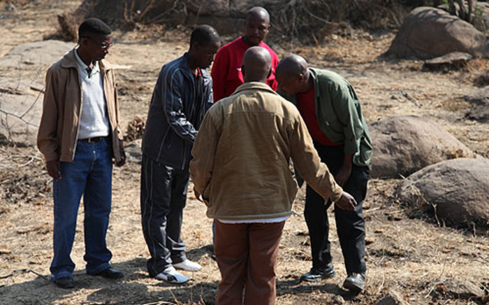 FILE: People linked to miners killed in Marikana conduct a cleansing ritual where the 2012 shooting happened.