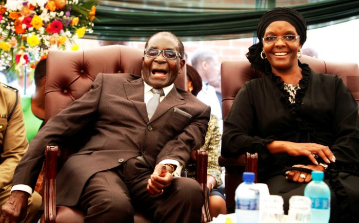 FILE: Zimbabwean President Robert Mugabe aNd his wife, Grace Mugabe. Picture: AFP.