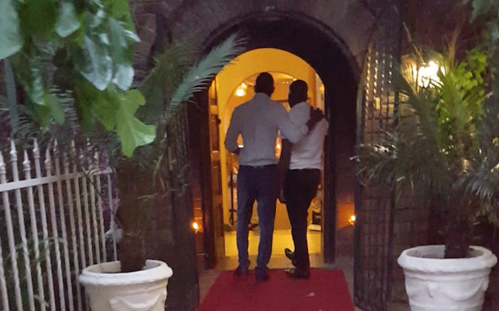 FILE: Eyewitness News journalists Clement Manyathela & Hitekani Magwedze present themselves as a gay couple at the entrance of The Lake Restaurant in Brakpan. Picture: Louise McAuliffe/EWN.