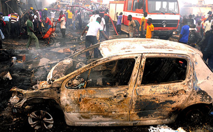 FILE: Nigerian firefighters and rescuers extinguish a fire at Terminus market in the central city of Jos after twin car bombings killed 118 and injured 45 on 20 May 2014. Picture:  AFP.