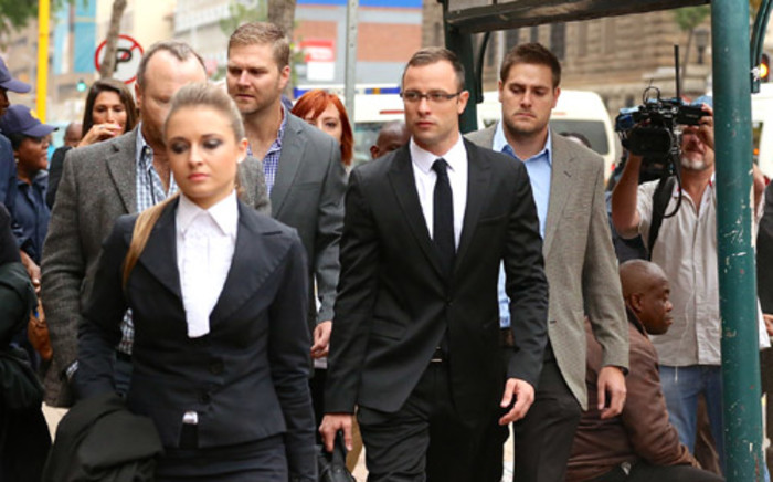Oscar Pistorius arrives at the High in Pretoria ahead of day 10 of his murder trial on 14 March 2014. Picture: Aletta Gardner/EWN.