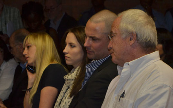 Oscar Pistorius's father (right), brother (middle) and sister (second from left) in the Pretoria Magistrates Court where the Paralympic athlete is applying for bail. Picture: Lesego Ngobeni/EWN.