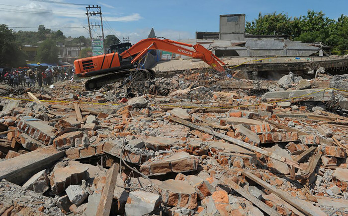 FILE: The wreckage of a shop which was destroyed after an earthquake. Picture: AFP.