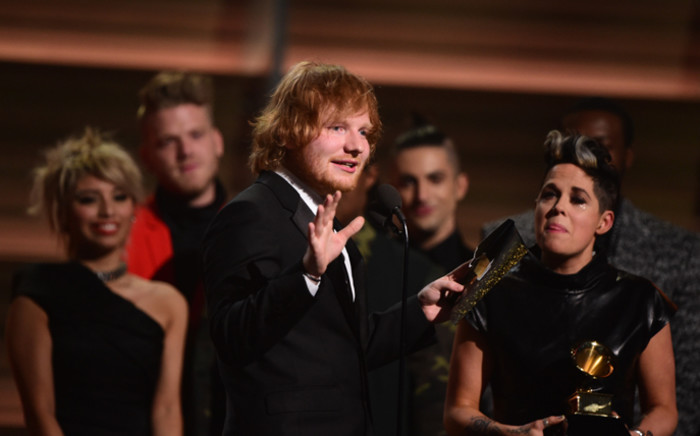 Ed Sheeran recieves the award for the Song of the Year, 'Thinking Out Loud' during the 58th Annual Grammy Awards in Los Angeles on 15 February, 2016. Picture: AFP.