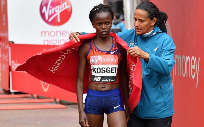 Kenya's Brigid Kosgei is wrapped in a towel after winning the elite women's race of the 2019 London Marathon in central London on April 28, 2019.