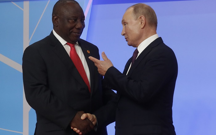 FILE: Russian President Vladimir Putin greets President Cyril Ramaphosa during the official welcoming ceremony for the heads of state and government of states participating in the 2019 Russia-Africa Summit in Sochi on 23 October 2019. Picture: AFP.