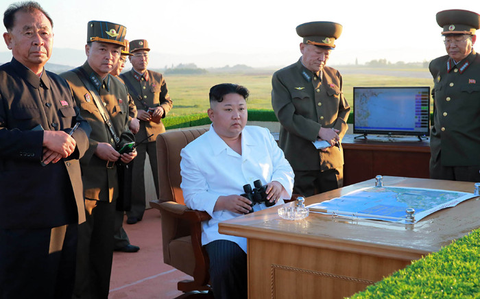 This undated picture released by North Korea's official Korean Central News Agency (KCNA) on 28 May, 2017, shows North Korean leader Kim Jong-Un (C) inspecting the test of a new anti-aircraft guided weapon system organised by the Academy of National Defence Science at an undisclosed location. Picture: AFP.