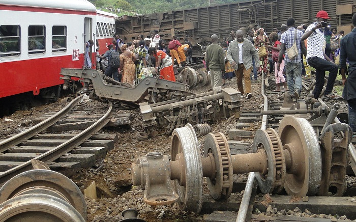 Passenger escape the site of a train derailment in Eseka on October 21, 2016. Picture: AFP