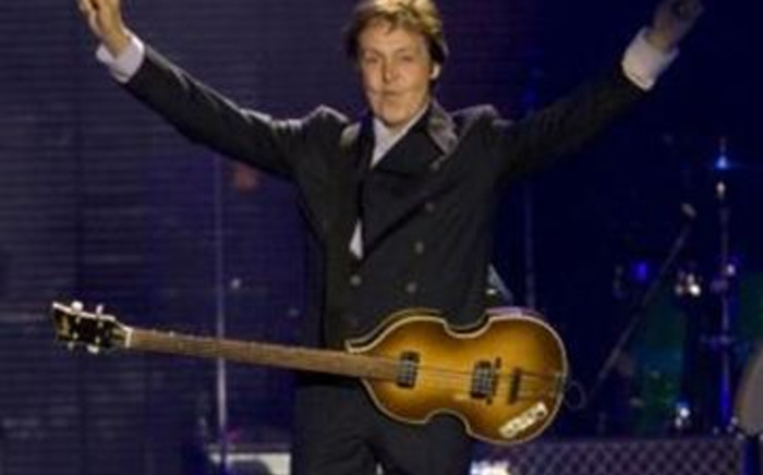 The former Beatle performed a surprise mini-concert in New York's Times Square. Picture: AFP