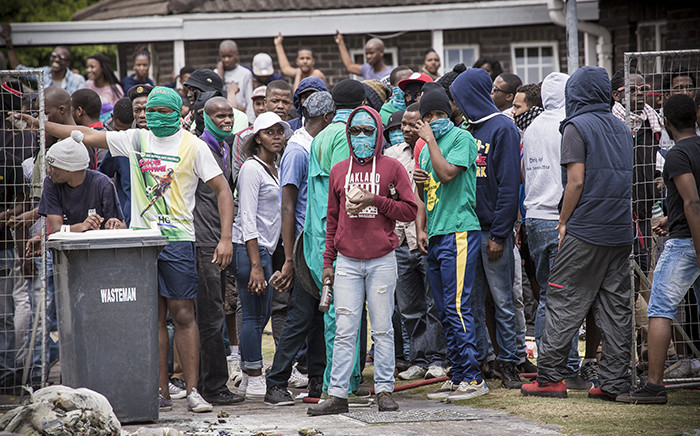Students prepare for clashes with police at the University of the Western Cape on 11 November 2015. Picture: Thomas Holder/EWN