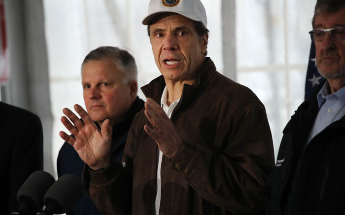 New York Governor Andrew Cuomo speaks to the media and tours a newly opened drive through COVID-19 mobile testing center on 13 March 2020 in New Rochelle, New York. Picture: AFP