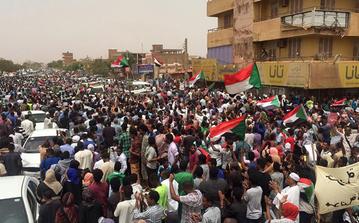 FILE: Sudanese protestors chant slogans demanding civilian rule on 30 June 2019 during a rally in Khartoum's southern al-Sahafa district. Police fired tear gas at protesters in Khartoum as thousands gathered for a mass demonstration against Sudan's ruling generals, amid international calls for restraint to avoid a new deadly crackdown. Picture: AFP.