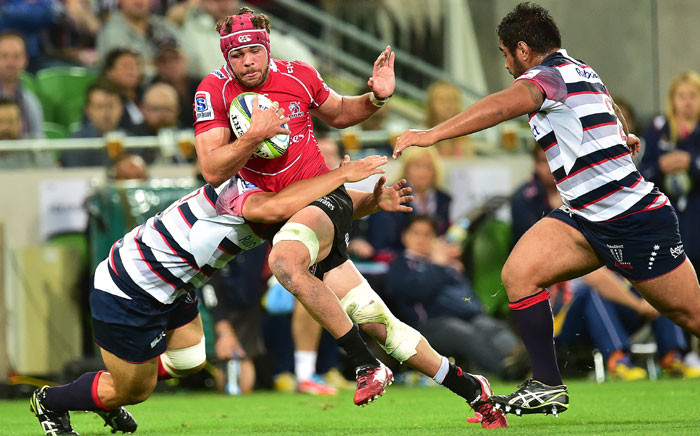 Lions captain Warren Whiteley (C) is tackled during the round six Super Rugby match between Melbourne Rebels and The Lions at AAMI Park in Melbourne, Australia, 20 March 2015. Picture:EPA