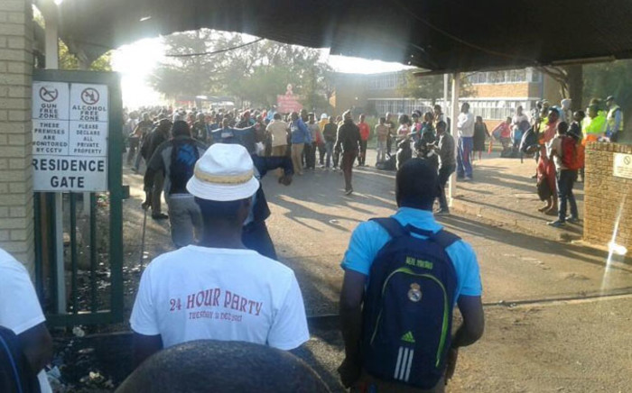 Vaal University of Technology student gathering at the main gate of the campus during protest on 9 September 2014. Picture: IamCollenThwala ‏via Twitter.