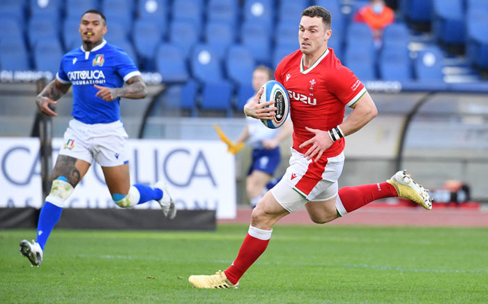 Wales' wing George North (R) runs on his way to score a try during the Six Nations match between Italy and Wales on 13 March 2021 at the Olympic stadium in Rome. Picture: Tiziana Fabi/AFP