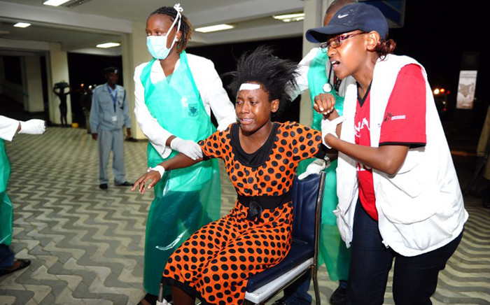 FILE: Paramedics attend to an injured Kenyan student as she is wheeled into Kenyatta National Hospital in Nairobi on 2 April, 2015, following an attack at Garissa University College. Picture: AFP.