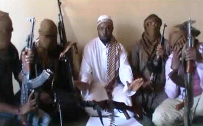 FILE: A screengrab taken from a video released on You Tube on April 12, 2012 apparently shows Boko Haram leader Abubakar Shekau (C) sitting flanked by militants.Picture:AFP.