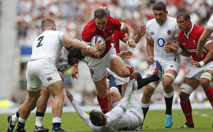 Wales' wing George North (C) gets tackled during the international Test rugby union match between England and Wales at Twickenham Stadium in west London on 11 August 2019. Picture: AFP